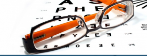 Glasses ontop of an eye test